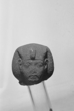 <em>Fragmentary Figure of Akhenaten</em>, ca. 1352-1336 B.C.E. Quartzite or sandstone, 2 3/16 x 2 1/16 in. (5.5 x 5.3 cm). Brooklyn Museum, Charles Edwin Wilbour Fund, 37.514. Creative Commons-BY (Photo: Brooklyn Museum, 37.514_front_bw.jpg)