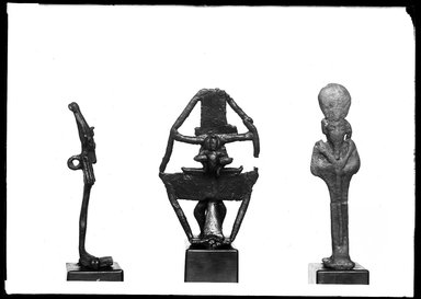 <em>Small Statuette of Osiris with Ring for Suspension at Base and Top</em>, 305-30 B.C.E. Bronze, 2 13/16 x 13/16 x 9/16 in. (7.1 x 2 x 1.5 cm). Brooklyn Museum, Charles Edwin Wilbour Fund, 37.540E. Creative Commons-BY (Photo: , 37.540E_37.545E_37.549E_GrpA_SL4.jpg)