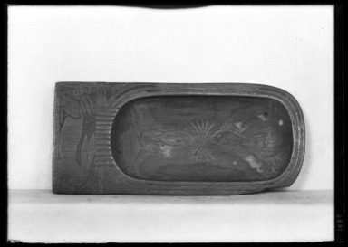 <em>Cosmetic Dish in Form of Cartouche Containing Fish</em>, ca. 1539-1292 B.C.E. Wood, frit, 2 1/8 x 4 5/8 in. (5.4 x 11.8 cm). Brooklyn Museum, Charles Edwin Wilbour Fund, 37.608E. Creative Commons-BY (Photo: Brooklyn Museum, 37.608E_NegA_SL4.jpg)