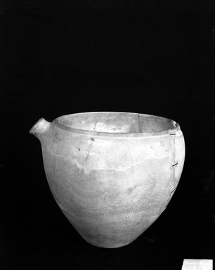 <em>Vessel with Spout</em>, ca. 2675-2170 B.C.E. Egyptian alabaster (calcite), 10 1/4 x Diam. 12 1/16 in. (26 x 30.6 cm). Brooklyn Museum, Charles Edwin Wilbour Fund, 37.68E. Creative Commons-BY (Photo: Brooklyn Museum, 37.68E_NegA_glass_bw.jpg)