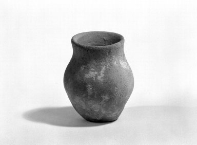 Indus Valley Culture. <em>Miniature Jar</em>, 3000-2500 B.C.E. Reddish pottery, 1 9/16 x 1 1/4 in. (3.9 x 3.1 cm). Brooklyn Museum, A. Augustus Healy Fund, 37.68. Creative Commons-BY (Photo: Brooklyn Museum, 37.68_bw.jpg)
