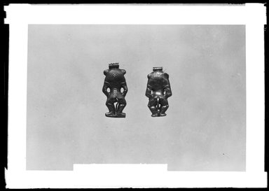 <em>Amulet of the God Bes</em>, ca. 1390-1322 B.C.E. Electrum, 1 5/16 x 11/16 x 5/16 in. (3.3 x 1.7 x 0.8 cm). Brooklyn Museum, Charles Edwin Wilbour Fund, 37.711E. Creative Commons-BY (Photo: , 37.710E_37.711E_GrpA_SL4.jpg)