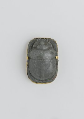 <em>Heart Scarab</em>, 664-525 B.C.E. Steatite, gold, 7/8 x 1 7/16 x 2 1/16 in. (2.3 x 3.6 x 5.3 cm). Brooklyn Museum, Charles Edwin Wilbour Fund, 37.717E. Creative Commons-BY (Photo: Brooklyn Museum, 37.717E_front_PS2.jpg)
