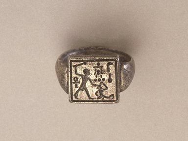 <em>Signet Ring Bearing the Name of Amunhotep II</em>, ca. 1426-1400 B.C.E. Silver, Central design: width 1/2 x length 1/2 in. (1.3 x 1.3 cm). Brooklyn Museum, Charles Edwin Wilbour Fund, 37.726E. Creative Commons-BY (Photo: Brooklyn Museum, 37.726E_reference_SL1.jpg)