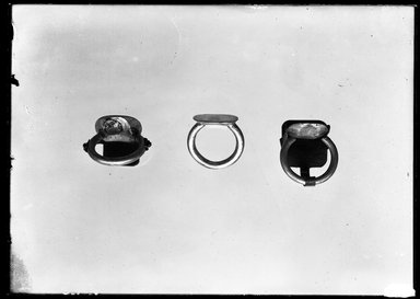 <em>Unfinished Signet Ring</em>, ca. 664-525 B.C.E. Silver, 9/16 x Diam. 7/8 x 3/4 in. (1.5 x 2.3 x 1.9 cm). Brooklyn Museum, Charles Edwin Wilbour Fund, 37.736E. Creative Commons-BY (Photo: , 37.735E_37.736E_37.737E_GrpA_SL4.jpg)