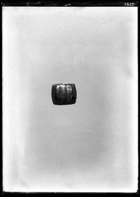 <em>Earring</em>, ca. 1539-1190 B.C.E. Silver, gold Brooklyn Museum, Charles Edwin Wilbour Fund, 37.745E. Creative Commons-BY (Photo: Brooklyn Museum, 37.745E_NegA_SL4.jpg)