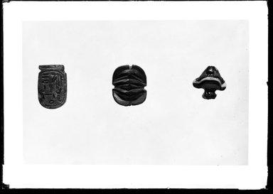 <em>Heart Amulet</em>, ca. 1479-1292 B.C.E. Glass, 7/8 x 7/8 x 7/16 in. (2.2 x 2.2 x 1.1 cm). Brooklyn Museum, Charles Edwin Wilbour Fund, 37.1260E. Creative Commons-BY (Photo: , 37.879E_37.1216E_37.1260E_GrpA_SL4.jpg)