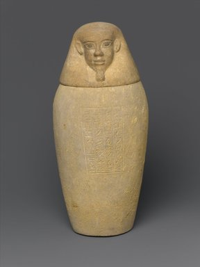 <em>Canopic Jar and Lid (Depicting a Human)</em>, 664-404 B.C.E. Limestone, 10 7/16 in. (26.5 cm) high x 4 1.2 in. (11.4 cm) diameter. Brooklyn Museum, Charles Edwin Wilbour Fund, 37.896Ea-b. Creative Commons-BY (Photo: Brooklyn Museum, 37.896Ea-b_front_PS1.jpg)
