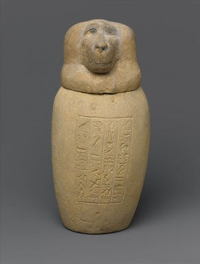 <em>Canopic Jar and Lid (Depicting a Baboon)</em>, 664-525 B.C.E. or later. Limestone, 9 3/4 x Diam. 4 3/4 in. (24.8 x 12.1 cm). Brooklyn Museum, Charles Edwin Wilbour Fund, 37.897Ea-b. Creative Commons-BY (Photo: Brooklyn Museum, 37.897Ea-b_front_PS1.jpg)