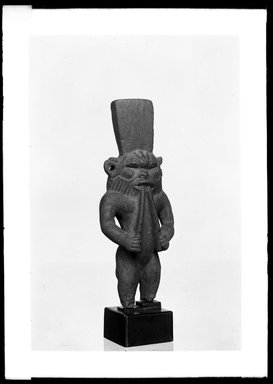 <em>Figure of the God Bes Playing on a Pair of Flutes</em>. Wood, Height: 3 3/4 in. (9.6 cm). Brooklyn Museum, Charles Edwin Wilbour Fund, 37.916E. Creative Commons-BY (Photo: Brooklyn Museum, 37.916E_NegA_SL4.jpg)