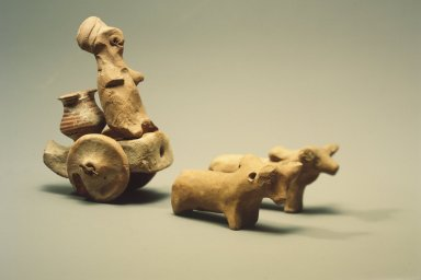 Indus Valley Culture. <em>Body of a Toy Chariot</em>, 3000-2500 B.C. Reddish pottery, with modern shaft and axle: 3 1/8 x 6 1/8 in. (8 x 15.5 cm). Brooklyn Museum, A. Augustus Healy Fund, 37.92. Creative Commons-BY (Photo: Brooklyn Museum, 37.92.jpg)