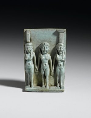 <em>Triad of Isis, the Child Horus, and Nephthys</em>, 305-30 B.C.E. Faience, 2 x 1 7/16 x 5/8 in. (5.1 x 3.6 x 1.6 cm). Brooklyn Museum, Charles Edwin Wilbour Fund, 37.939E. Creative Commons-BY (Photo: Brooklyn Museum, 37.939E_front_PS2.jpg)