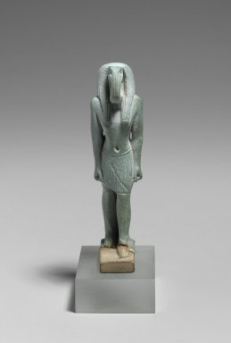 <em>Figure of the God Thoth</em>, 664-332 B.C.E. Faience, glazed, 2 7/8 x 3/4 x 1 3/16 in. (7.3 x 1.9 x 3 cm). Brooklyn Museum, Charles Edwin Wilbour Fund, 37.946E. Creative Commons-BY (Photo: Brooklyn Museum, 37.946E_front_PS2.jpg)