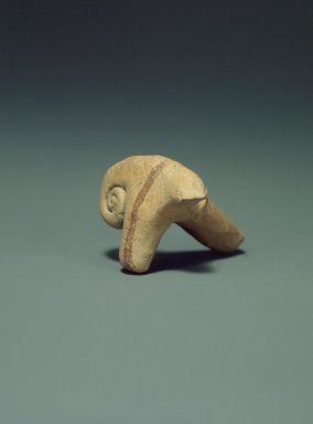 Indus Valley Culture. <em>Small Toy Ram's Head</em>, 3000-2500 B.C.E. Reddish pottery, 2 3/8 x 2 1/16 in. (6 x 5.2 cm). Brooklyn Museum, A. Augustus Healy Fund, 37.95. Creative Commons-BY (Photo: Brooklyn Museum, 37.95.jpg)