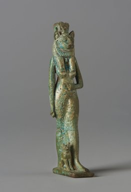 <em>Amulet of a Lion-Headed Goddess with Cat</em>, ca. 1075-30 B.C.E. Faience, 3 1/4 x 3/4 x 1 in. (8.2 x 2 x 2.5 cm). Brooklyn Museum, Charles Edwin Wilbour Fund, 37.977E. Creative Commons-BY (Photo: Brooklyn Museum, 37.977E_PS11.jpg)