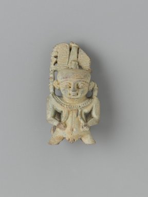 <em>Amulet of Pataikos</em>, 664-332 B.C.E. Faience, 2 3/8 × 1 1/4 × 7/8 in. (6 × 3.1 × 2.3 cm). Brooklyn Museum, Charles Edwin Wilbour Fund, 37.997E. Creative Commons-BY (Photo: Brooklyn Museum, 37.997E_PS2.jpg)