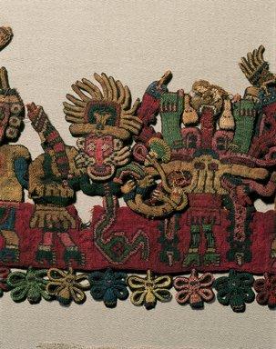 "Nazca. <em>Mantle (""The Paracas Textile"")</em>, 100-300 C.E. Cotton, camelid fiber, 24 5/8 × 58 11/16 in. (62.5 × 149 cm). Brooklyn Museum, John Thomas Underwood Memorial Fund, 38.121 (Photo: Brooklyn Museum, 38.121_border_figure08_color_corrected_IMLS.jpg)"