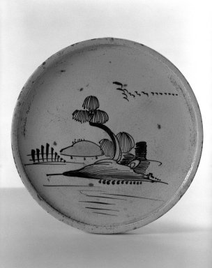 <em>Oil Dish</em>, late 19th-early 20th century. Glazed stoneware with underglaze iron decoration; Seto ware, Oribe style, 13/16 x 8 3/4 in. (2.1 x 22.2 cm). Brooklyn Museum, By exchange, 38.146. Creative Commons-BY (Photo: Brooklyn Museum, 38.146_bw.jpg)