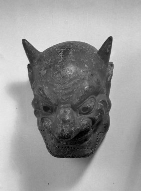 <em>Mask</em>, 14th century (possibly). Lacquered cloth, 11 x 7 7/8 x 5 7/8 in. (28 x 20 x 15 cm). Brooklyn Museum, Gift of Mrs. Willard D. Straight, by exchange, 38.18. Creative Commons-BY (Photo: Brooklyn Museum, 38.18_acetate_bw.jpg)