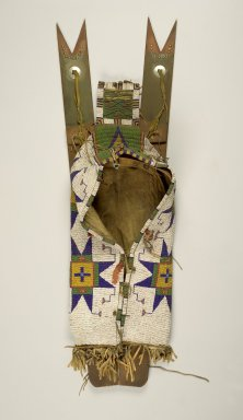 Sioux. <em>Cradle with Attached Toys</em>, 1870-1900. Buffalo hide, wood, beads, metal, ceramic, porcupine quills, brass nails, pigment, 32 5/16 x 12 3/16 x 7 in. (82.1 x 31 x 17.8 cm). Brooklyn Museum, Dick S. Ramsay Fund, 38.630. Creative Commons-BY (Photo: Brooklyn Museum, 38.630.jpg)