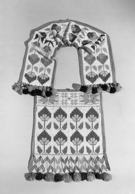 Hochunk. <em>Bandolier Bag</em>, early 20th century. Beads, cloth, wool, silk, and metal bells, 39 3/8 × 19 in. (100 × 48.3 cm). Brooklyn Museum, Dick S. Ramsay Fund, 38.632. Creative Commons-BY (Photo: Brooklyn Museum, 38.632_acetate_bw.jpg)