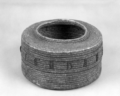 Eskimo. <em>Cylindrical Coiled Basket</em>. Reed, hide, 10 1/2 x 6 1/4 in. or (15.5 x 18.0 cm). Brooklyn Museum, Dick S. Ramsay Fund, 38.636. Creative Commons-BY (Photo: Brooklyn Museum, 38.636_bw.jpg)