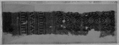 <em>Egypto-Arabic Textile, Fragment of Hanging? found in Egypt</em>, 16th-17th century. Textile, 20 1/16 x 4 5/16 in. (51 x 11 cm). Brooklyn Museum, Charles Edwin Wilbour Fund, 38.840. Creative Commons-BY (Photo: Brooklyn Museum, 38.840_acetate_bw.jpg)