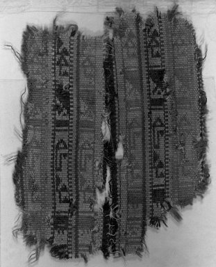 <em>Egypto-Arabic Textile, Braid</em>, 13th-15th century. Wool, ribbed cloth, 4 5/16 x 5 1/2 in. (11 x 14 cm). Brooklyn Museum, Charles Edwin Wilbour Fund, 38.843. Creative Commons-BY (Photo: Brooklyn Museum, 38.843_acetate_bw.jpg)
