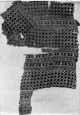 <em>Fragment of a Tunic</em>, 12th-15th century. Printed Cotton, 19 11/16 x 13 3/4 in. (50 x 35 cm). Brooklyn Museum, Charles Edwin Wilbour Fund, 38.846. Creative Commons-BY (Photo: Brooklyn Museum, 38.846_acetate_bw.jpg)