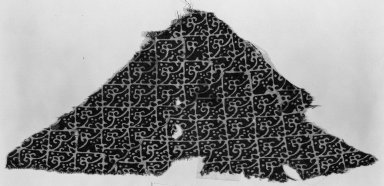 <em>Fostat Textile Fragment</em>, 12th-15th century. Printed cotton, 9 1/16 x 9 13/16 in. (23 x 25 cm). Brooklyn Museum, Charles Edwin Wilbour Fund, 38.847. Creative Commons-BY (Photo: Brooklyn Museum, 38.847_acetate_bw.jpg)