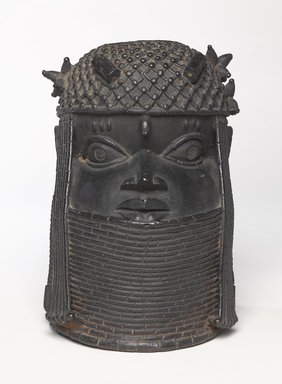 Edo. <em>Head of an Oba</em>, 18th century. Copper alloy, iron, 11 1/4 × 7 7/8 in. (28.5 × 20 cm). Brooklyn Museum, Alfred W. Jenkins Fund, 39.111. Creative Commons-BY (Photo: Brooklyn Museum, 39.111_overall_PS9.jpg)