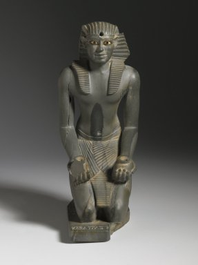 <em>Kneeling Statuette of Pepy I</em>, ca. 2338-2298 B.C.E. Greywacke, alabaster, obsidian, copper, 6 x 1 13/16 x 3 9/16 in. (15.2 x 4.6 x 9 cm). Brooklyn Museum, Charles Edwin Wilbour Fund, 39.121. Creative Commons-BY (Photo: Brooklyn Museum, 39.121_front_PS6.jpg)