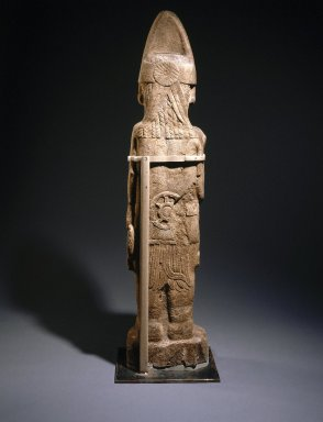 Huastec. <em>Warrior Figure</em>, ca. 1440-1521. Sandstone, 65 3/16 x 14 3/4 x 7 1/2 in. (165.6 x 37.5 x 19.1 cm). Brooklyn Museum, Frank L. Babbott Fund, 39.371. Creative Commons-BY (Photo: Brooklyn Museum, 39.371_back_SL1.jpg)