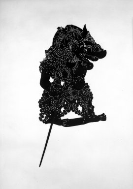 <em>Shadow Play Figure (Wayang kulit)</em>. Leather, pigment, wood, fiber, 26 × 14 15/16 in. (66 × 38 cm). Brooklyn Museum, Gift of S. Koperberg, 39.420. Creative Commons-BY (Photo: Brooklyn Museum, 39.420_acetate_bw.jpg)