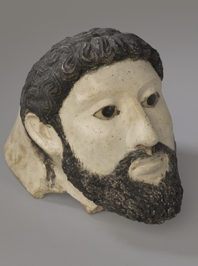 Graeco-Egyptian. <em>Mummy Mask</em>, second half 2nd century C.E. Plaster, pigment, glass, 7 15/16 x 6 9/16 x 10 7/16 in. (20.2 x 16.6 x 26.5 cm). Brooklyn Museum, Gift of Mrs. R. Riefstahl, 40.148. Creative Commons-BY (Photo: Brooklyn Museum, 40.148_threequarter_PS9.jpg)