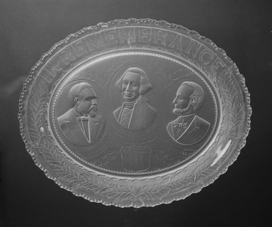 <em>Plate (George Washington, James Garfield, & Abraham Lincoln)</em>, 1881. Glass, 1 3/8 x 12 1/2 x 10 in. (3.5 x 31.8 x 25.4 cm). Brooklyn Museum, Gift of Mrs. William Greig Walker by subscription, 40.154. Creative Commons-BY (Photo: Brooklyn Museum, 40.154_bw.jpg)