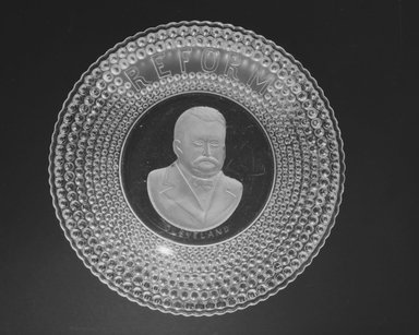 <em>Plate (Grover Cleveland)</em>, 1884-1889. Glass, 1 1/8 x 10 1/8 x 10 1/8 in. (2.9 x 25.7 x 25.7 cm). Brooklyn Museum, Gift of Mrs. William Greig Walker by subscription, 40.159. Creative Commons-BY (Photo: Brooklyn Museum, 40.159_bw.jpg)