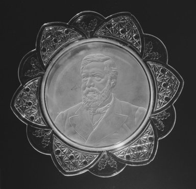 <em>Plate (James Blaine)</em>, ca. 1884. Glass, 1 1/4 x 11 3/8 x 11 3/8 in. (3.2 x 28.9 x 28.9 cm). Brooklyn Museum, Gift of Mrs. William Greig Walker by subscription, 40.160. Creative Commons-BY (Photo: Brooklyn Museum, 40.160_bw.jpg)
