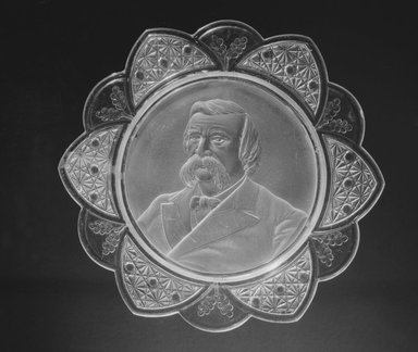 <em>Plate (John Logan)</em>, ca. 1884. Glass, 1 1/8 x 11 3/8 x 11 3/8 in. (2.9 x 28.9 x 28.9 cm). Brooklyn Museum, Gift of Mrs. William Greig Walker by subscription, 40.162. Creative Commons-BY (Photo: Brooklyn Museum, 40.162_bw.jpg)