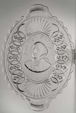 <em>Platter (George Washington)</em>, ca. 1876. Glass, 1 1/2 x 8 1/2 x 12 in. (3.8 x 21.6 x 30.5 cm). Brooklyn Museum, Gift of Mrs. William Greig Walker by subscription, 40.164. Creative Commons-BY (Photo: Brooklyn Museum, 40.164.jpg)