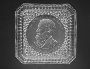 <em>Plate (Ulysses S. Grant)</em>, 1885. Glass, 1 1/2 x 9 5/8 x 9 3/8 in. (3.8 x 24.4 x 23.8 cm). Brooklyn Museum, Gift of Mrs. William Greig Walker by subscription, 40.166. Creative Commons-BY (Photo: Brooklyn Museum, 40.166_bw.jpg)