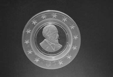 <em>Plate (James Garfield)</em>, ca. 1881. Glass, 1 x 6 x 6 in. (2.5 x 15.2 x 15.2 cm). Brooklyn Museum, Gift of Mrs. William Greig Walker by subscription, 40.168. Creative Commons-BY (Photo: Brooklyn Museum, 40.168_bw.jpg)