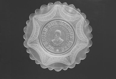 <em>Plate (James Garfield)</em>, ca. 1881. Glass, 1/2 x 11 1/2 x 11 1/2 in. (1.3 x 29.2 x 29.2 cm). Brooklyn Museum, Gift of Mrs. William Greig Walker by subscription, 40.170. Creative Commons-BY (Photo: Brooklyn Museum, 40.170_bw.jpg)