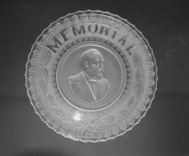 <em>Plate (James Garfield)</em>, ca. 1881. Glass, 1 1/4 x 10 x 10 in. (3.2 x 25.4 x 25.4 cm). Brooklyn Museum, Gift of Mrs. William Greig Walker by subscription, 40.172. Creative Commons-BY (Photo: Brooklyn Museum, 40.172_bw.jpg)