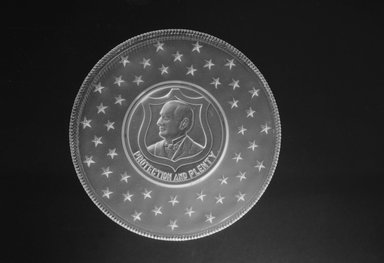 <em>Plate (William McKinley)</em>, ca. 1896. Glass, 1 x 7 1/4 x 7 1/4 in. (2.5 x 18.4 x 18.4 cm). Brooklyn Museum, Gift of Mrs. William Greig Walker by subscription, 40.173. Creative Commons-BY (Photo: Brooklyn Museum, 40.173_acetate_bw.jpg)