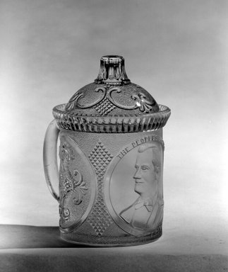 <em>Mug with Lid (William McKinley)</em>, ca. 1896. Glass, Overall: 5 x 4 x 3 3/8 in. (12.7 x 10.2 x 8.6 cm). Brooklyn Museum, Gift of Mrs. William Greig Walker by subscription, 40.175a-b. Creative Commons-BY (Photo: Brooklyn Museum, 40.175_bw.jpg)