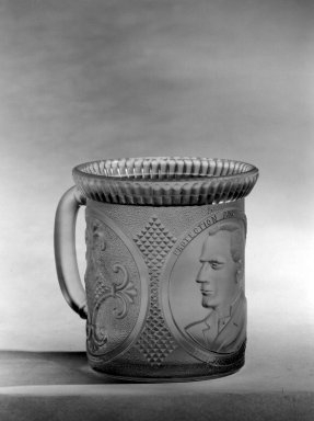 <em>Mug</em>, ca. 1896. Glass, 3 5/8 x 4 x 3 3/8 in. (9.2 x 10.2 x 8.6 cm). Brooklyn Museum, Gift of Mrs. William Greig Walker by subscription, 40.176. Creative Commons-BY (Photo: Brooklyn Museum, 40.176_bw.jpg)