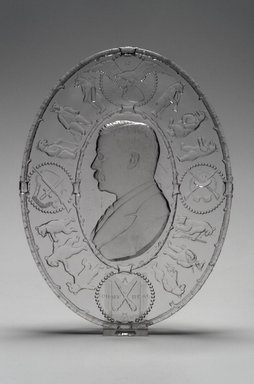 American. <em>Plate (Theodore Roosevelt)</em>, 1904. Glass, 1 1/8 x 7 7/8 x 10 3/8 in. (2.9 x 20 x 26.4 cm). Brooklyn Museum, Gift of Mrs. William Greig Walker by subscription, 40.177. Creative Commons-BY (Photo: Brooklyn Museum, 40.177.jpg)