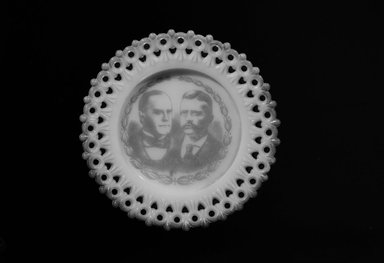 American. <em>Plate (William McKinley & Theodore Roosevelt)</em>, 1901. Glass, 3/4 x 5 3/8 x 5 3/8 in. (1.9 x 13.7 x 13.7 cm). Brooklyn Museum, Gift of Mrs. William Greig Walker by subscription, 40.181. Creative Commons-BY (Photo: Brooklyn Museum, 40.181_bw.jpg)
