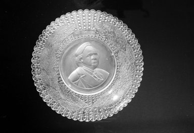 <em>Plate (Henry Ward Beecher)</em>, ca. 1887. Glass, 1 3/8 x 9 1/4 x 9 1/4 in. (3.5 x 23.5 x 23.5 cm). Brooklyn Museum, Gift of Mrs. William Greig Walker by subscription, 40.186. Creative Commons-BY (Photo: Brooklyn Museum, 40.186_bw.jpg)